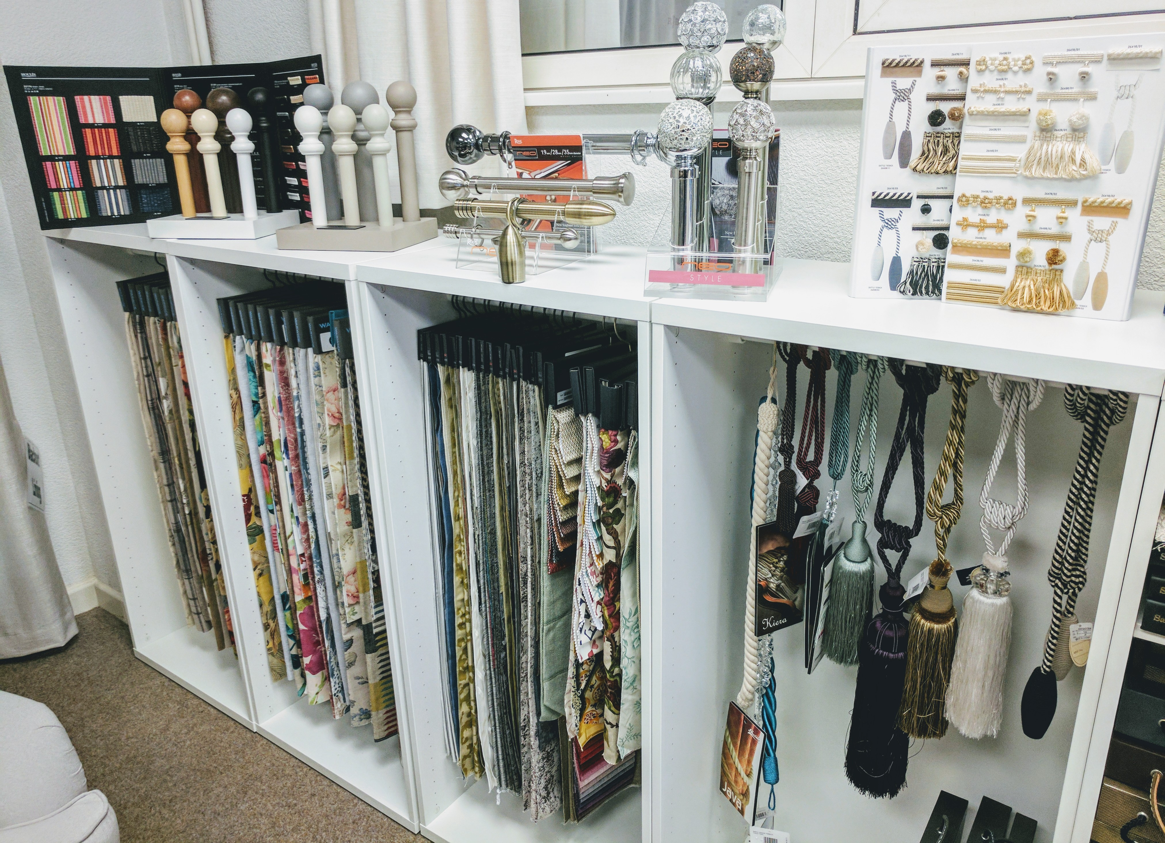 Fabric, poles and finials display at our littleborough showroom