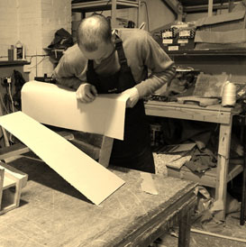 Upholsterer at work foaming a frame